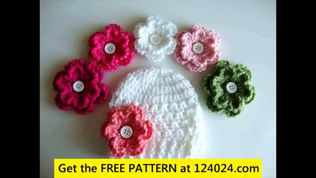 Crochet baby hat with pom poms