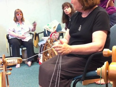 Judith Mackenzie demonstrating how to ply three-ply yarn
