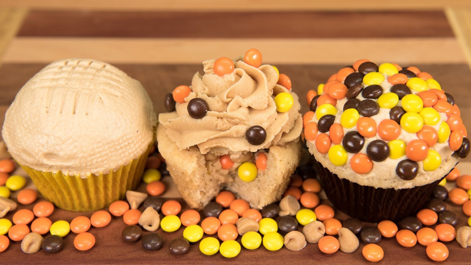 Candy Stuffed Peanut Butter Cupcakes with Peanut Butter Frosting from Cookies Cupcakes and Cardio
