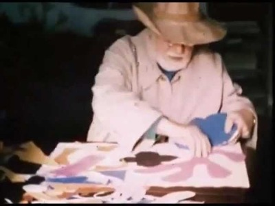 Footage of Henri Matisse making a paper cut out