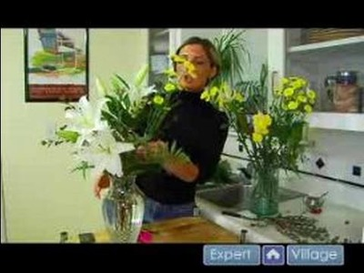 How to Make Flower Arrangements : Adding Flowers Evenly To Your Flower Arrangement