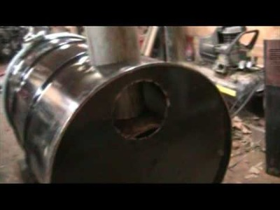 Home made wood stove from hot water heater and 55 gallon drum for outdoor use