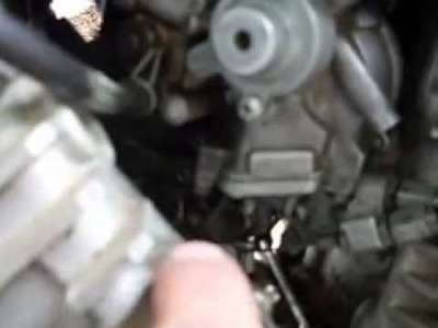 How to remove and install  a carburetor on a Kawasaki vulcan 750