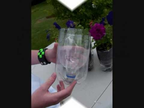 Soda bottle self watering plant container.wmv