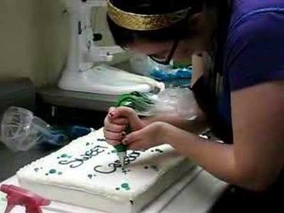 Hot Chocolates Bakery- Molly the Intern decorates a cake
