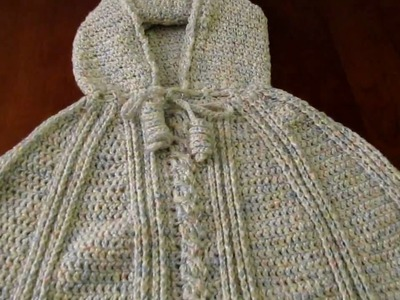 Crochet child hooded poncho with cable stitch