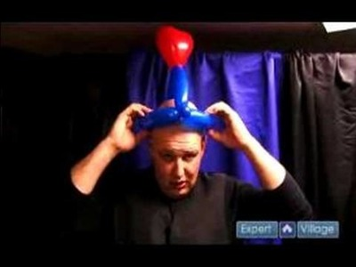 How to Make Balloon Hats : Adding Round Hearts to a Balloon Hat