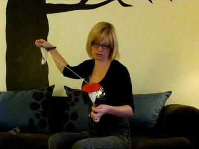 Drop Spinning Yarn with a Wrist Distaff - Timelapse