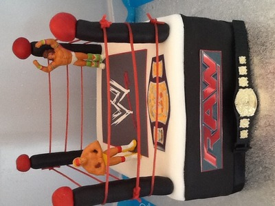 Wwe cake.   Wrestling. fondant .how to make.-roll fondant for posts then push bamboo stick through