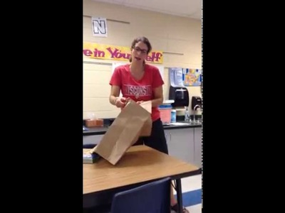 Covering a textbook with a paper bag