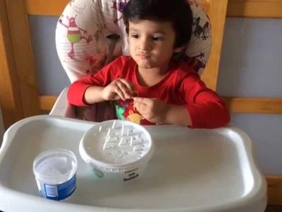 Moksh in a Montessori Inspired DIY Fine Motor & Hand-Eye Co Ordination skill activity with Straws