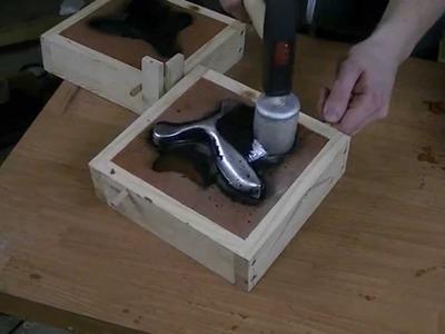 Casting an Aluminim Slingshot (green sand casting)