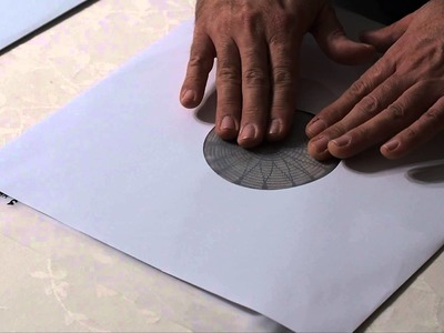 How to remove vinyl record from unlined paper sleeve without causing any scratches on the record
