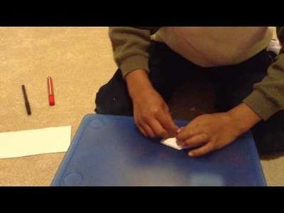 How to make a paper poké ball.