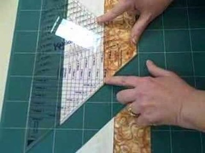 Using a 45 degree quilt ruler to make a spool block