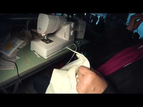 Blouse:  Sewing the neck edge, while attaching the collar.