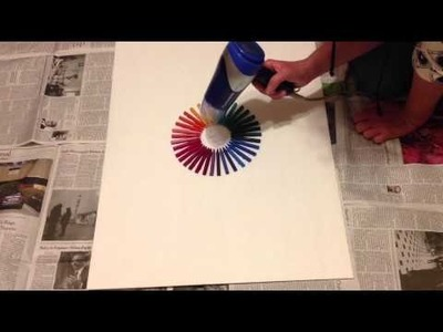 Make the rainbow with melted crayons!