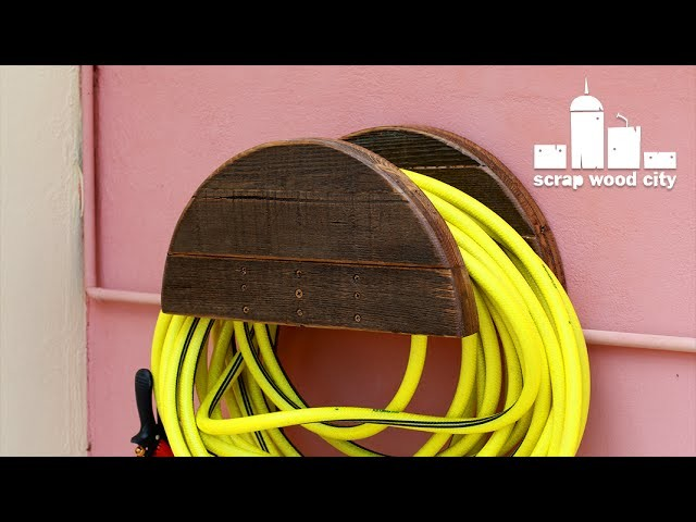 DIY garden hose hanger out of pallet wood