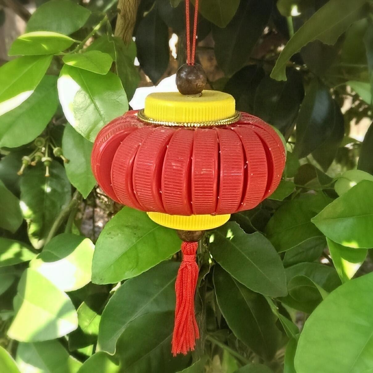 Recycled bottle cap lantern