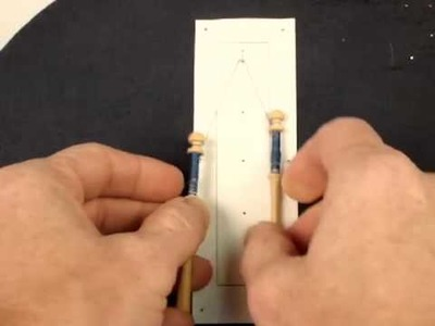 Hanging Pairs of Bobbins on a Pin