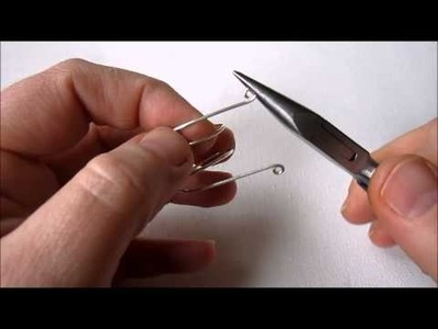 How to Make an Adjustable Wire Ring with Spirals and Bead
