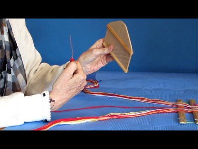 Threading the rigid heddle for narrow band weaving