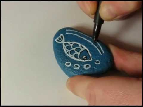 How to paint a stone and decorate it with a fish doodle