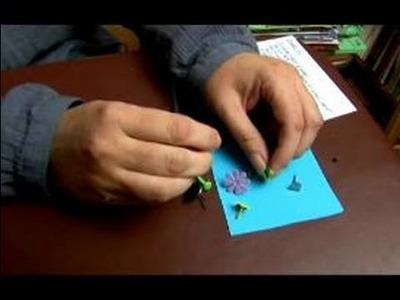 How to Use Embellishments in Scrapbooking : How to Add Brads to Scrapbooks