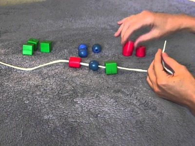 Stringing beads for infants and toddlers