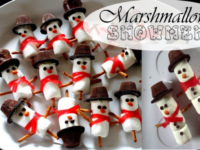 Marshmallow snowman winter treats and chocolate dipped pretzel sticks