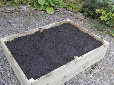 How To Fill A Raised Bed Using The Lasagna Method - DIY Home Tutorial - Guidecentral