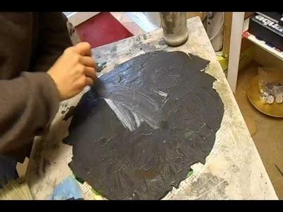 Preparing glass mosaic panel for transfer in bird bath basin.