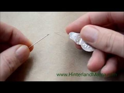 How to thread a needle using a reinforced Needle Threader - Video Tutorial