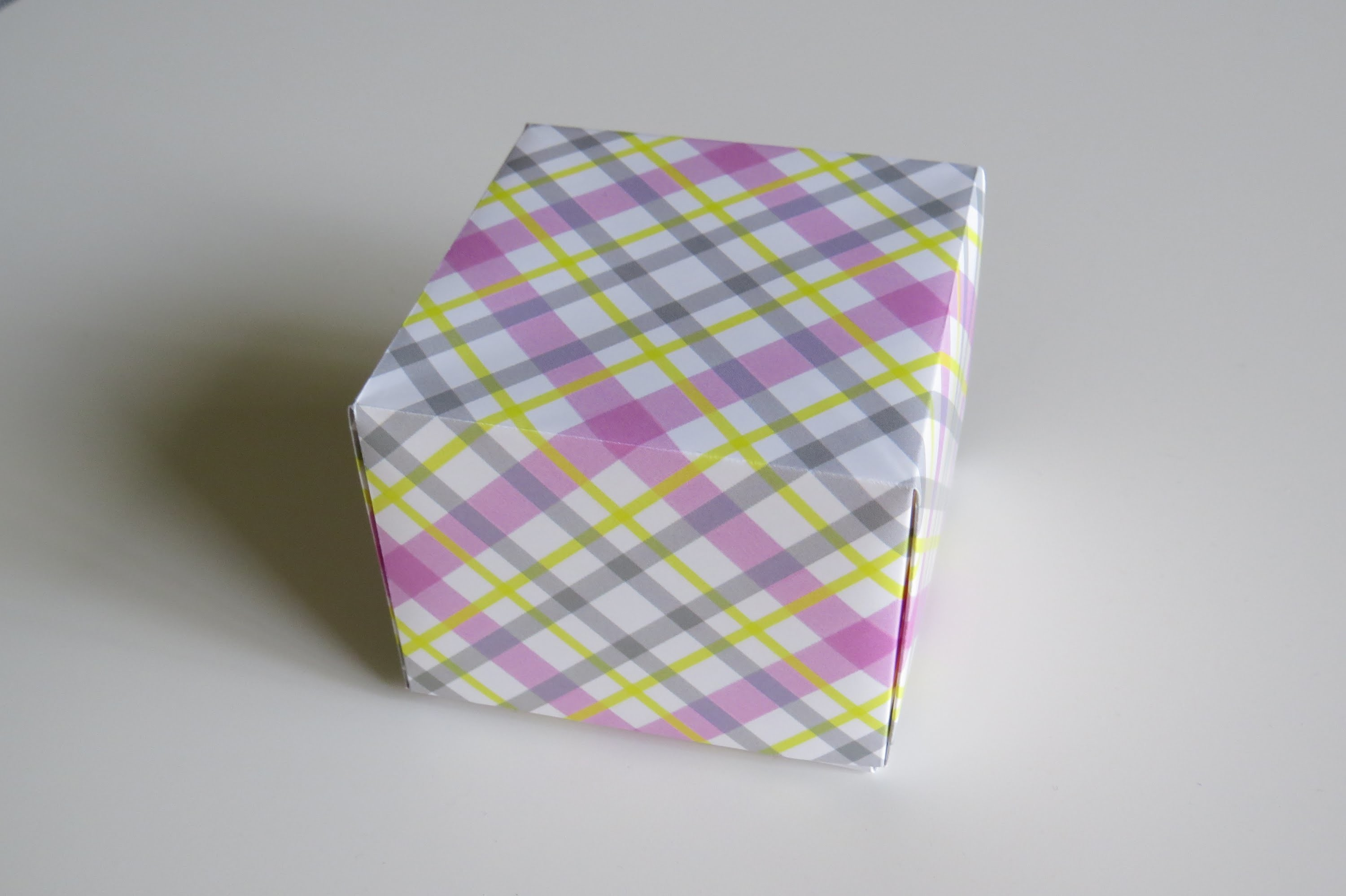 An Origami Box from  a Rectangular Sheet