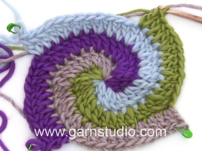 DROPS Crocheting Tutorial: How to work a Pot holder with stripes and spiral.