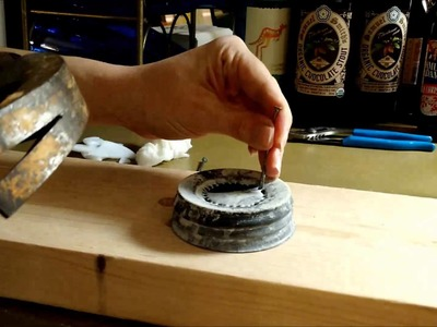How to make a hole in a mason jar lid that has glass inside