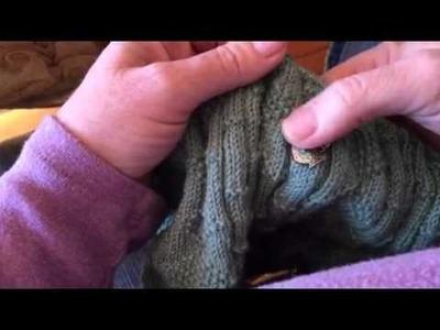Knitting on my gansey using knitting belt and long dpns
