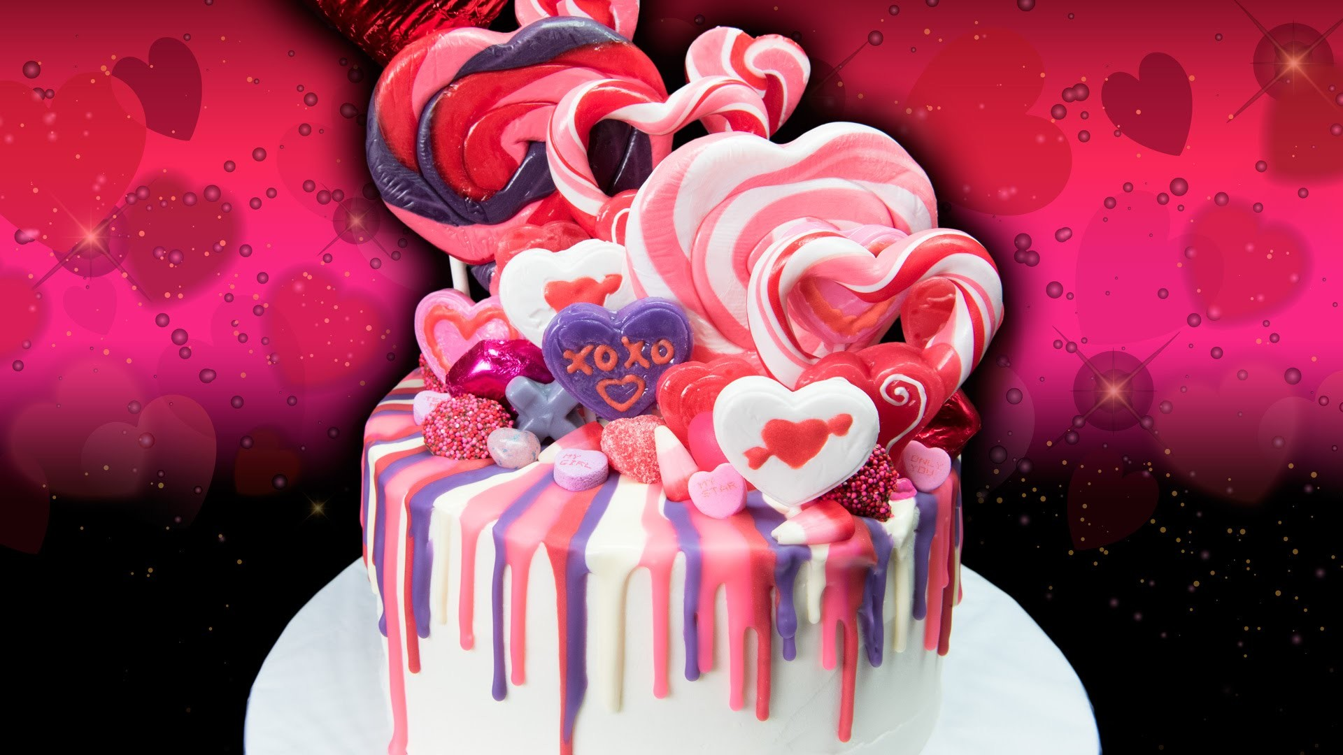 Valentine's Day Rainbow Drip Candy Cake  from Cookies Cupcakes and Cardio