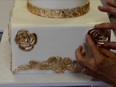 How to decorate a tiered cake in gold