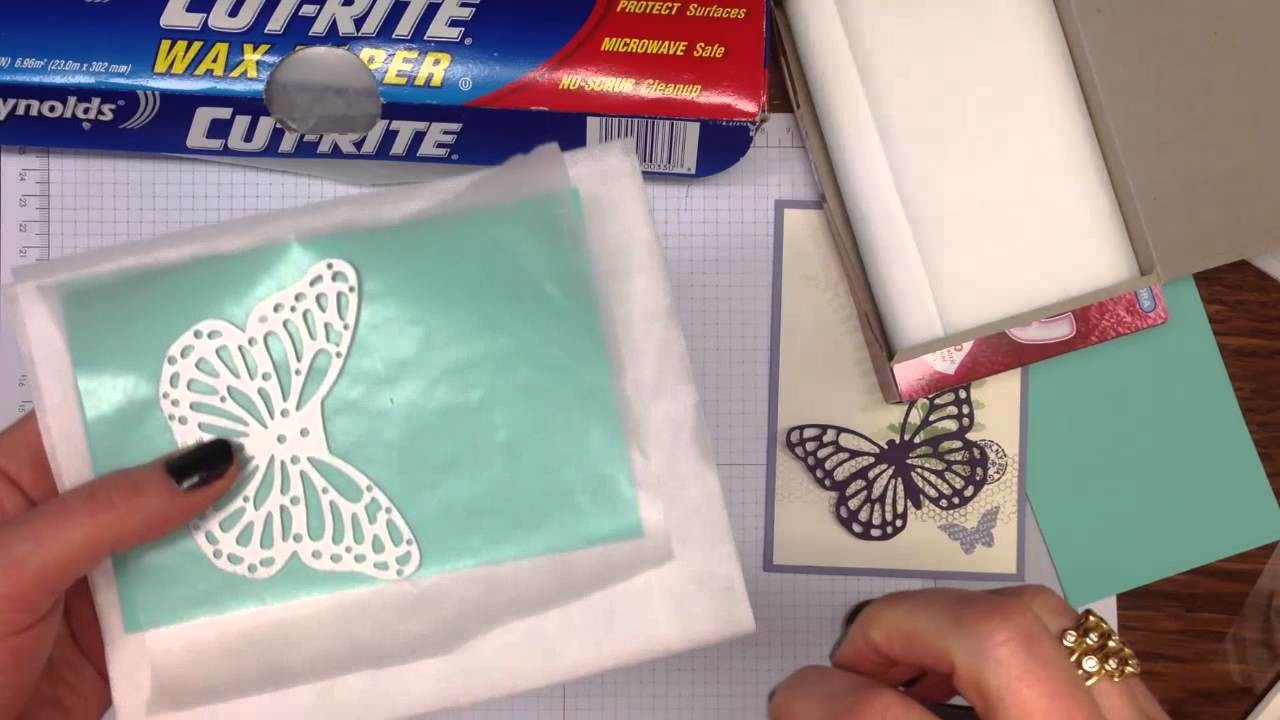 How to easily remove the intricate pieces from Stampin' Up! dies using dryer sheets and waxed paper.