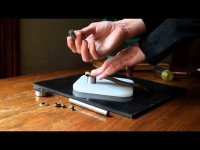 How to Set a Metal Ring Snap Using a Hand Tool