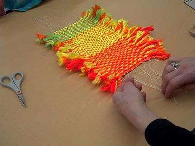 Taking a weaving off a loom