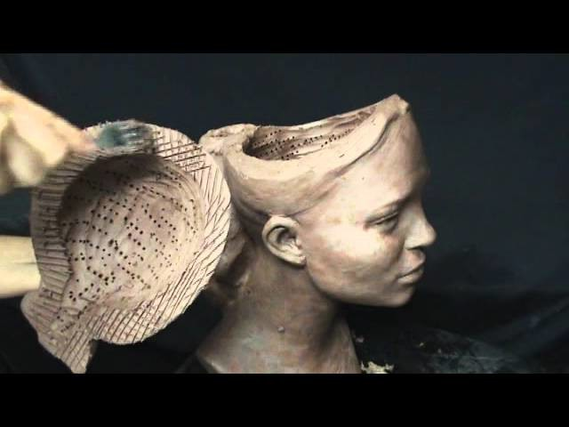 Hollowing sculpture. Preparing for firing in a kiln.
