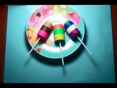Making of colorful lollipops from play-doh