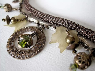 Handmade Vintaj Bracelet with Swarovski, Lucite and green Garnet