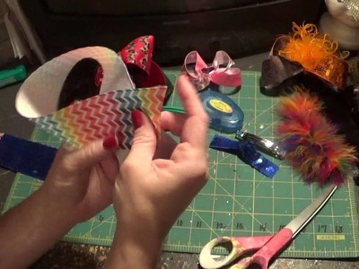 How to make a sequin two toned hair bow and add feathers.