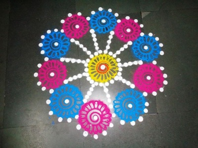 How to make beautiful flowers in easy rangoli design - created by latest rangoli