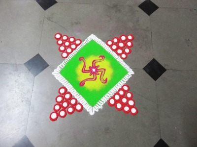 How to make swastik in square rangoli design   created by rangoli design