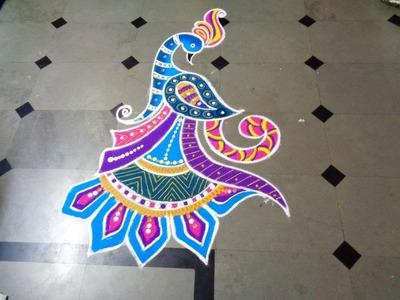 How tomake nice peacock rangoli design created by latest rangoli