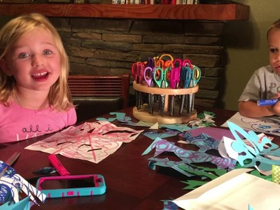 Makenna's DIY making winter snowflakes out of paper